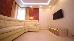 Stock Video Footage of Beautiful modern living room with leather sofa, TV and windows