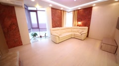 Stock Video Footage of Beautiful living room with leather sofa, TV and big windows