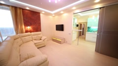 Stock Video Footage of modern living room with leather sofa overlooking kitchen