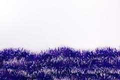 Stock Photo of blue tinsel isolated on white