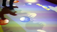 Legs of two children jumping on interactive floor in McDonalds Stock Footage