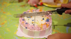 Hand with knife cuts beautiful sweet birthday cake Stock Footage