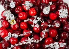 Jewels at cherries Stock Photos