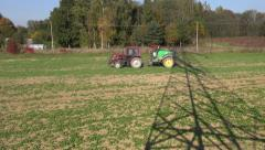 Agriculture tractor with spray tool on  field Stock Footage