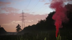 Red smoke in forest with swamp and transmission line Stock Footage