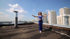 Woman dances against background of residential complex Stock Footage