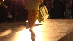 Fashion bright show slender young model walking on a catwalk Stock Footage