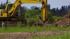 Excavator digging on job site - stock footage