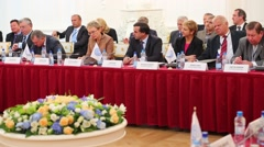 Participants listen on meeting of International Congress Stock Footage