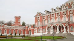 Facade of beautiful Petroff Palace with flag in Moscow Stock Footage