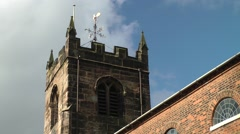 English church tower weathervane weather vane red brick Stock Footage