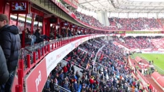 Lot of fans watching soccer at stadium Locomotive Stock Footage