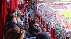 Fans look at field at stadium Locomotive (Locomotive - Spartak ) Stock Footage