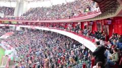 Fans look at football field at stadium Locomotive Stock Footage