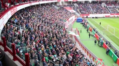 Many fans look at soccer field at stadium Locomotive - stock footage