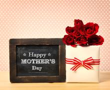 Happy Mothers Day message with roses and present box - stock photo