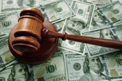 Judge gavel on cash Stock Photos