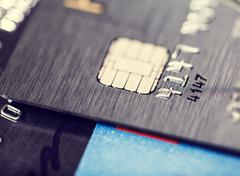 Microchip and numbers on a bank card - stock photo