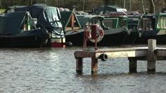Canal marina boats barges jetty lifebuoy Stock Footage