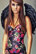 Glamour sexy dark angel girl Stock Photos