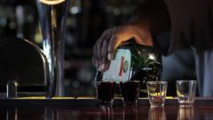 pouring alcohol at bar - stock footage
