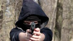 Masked Boy Filling Chargers And Shooting Seven Times From A Toy Gun, Ned Target, Stock Footage
