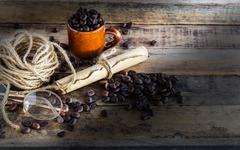 Old paper roll, glasses, rope reel and coffee beans on wooden Stock Photos