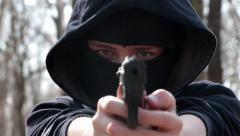 Masked Boy Filling Chargers And Shooting Seven Times From A Toy Gun, Ned Target Stock Footage