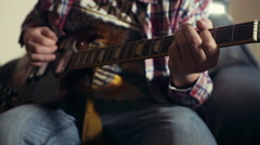 Man playing electric guitar slow motion Stock Footage
