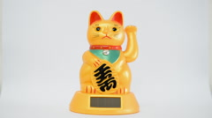 Oriental waving cat Stock Footage