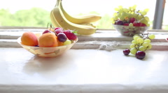 Different Summer fruits on a window sill Stock Footage