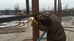 Worker welding a metal structure - stock footage