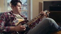 man playing electric guitar slow motion - stock footage