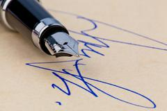 pen and signature - stock photo
