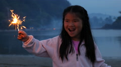 Girl with sparkler on Fourth of July - stock footage