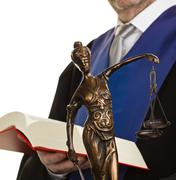 justice and judges with law book - stock photo