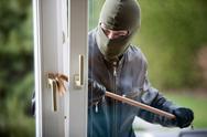 Burglar at a window Stock Photos