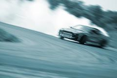Stock Photo of Very fast driving, motion blur blue color drift