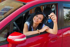 Young woman in car with car keys Stock Photos