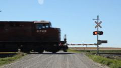 Rail crossing with freight train passing. Kemnay, Manitoba. Stock Footage