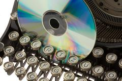 Old typewriter with cd-rom Stock Photos