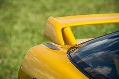Closeup detail of a custom racing spoiler on the rear of a sports car Stock Photos