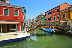 Venice landmark, Burano island canal, bridge, colorful houses and boats, Ital - stock photo