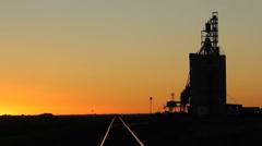 Reed lake grain elevator with train tracks. Saskatchewan, Canada. Stock Footage