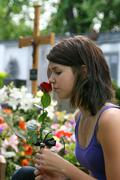 woman at the cemetery in a grave - stock photo