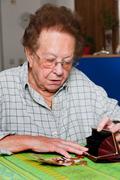 senior ranks of their money from pension - stock photo