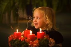 child with advent wreath for christmas - stock photo