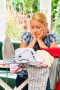 housewife ironing and ironing board - stock photo