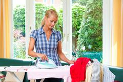 Housewife ironing and ironing board Stock Photos