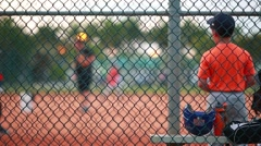 Children practicing baseball at park Stock Footage